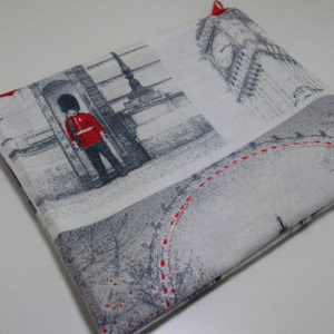 The back of the pouch shows a buckingham palace guard, big ben and the london eye