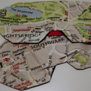 The front of the mask shows a map of london in beige, green and red colours with black, white and red highlights