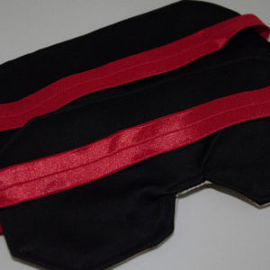 The back of the mask is a black blackout fabric. The band is bright red.